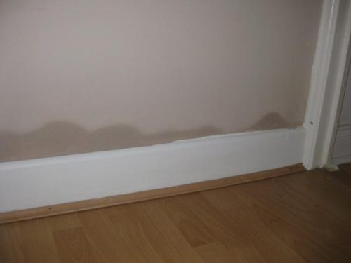 Image of rising damp on wall